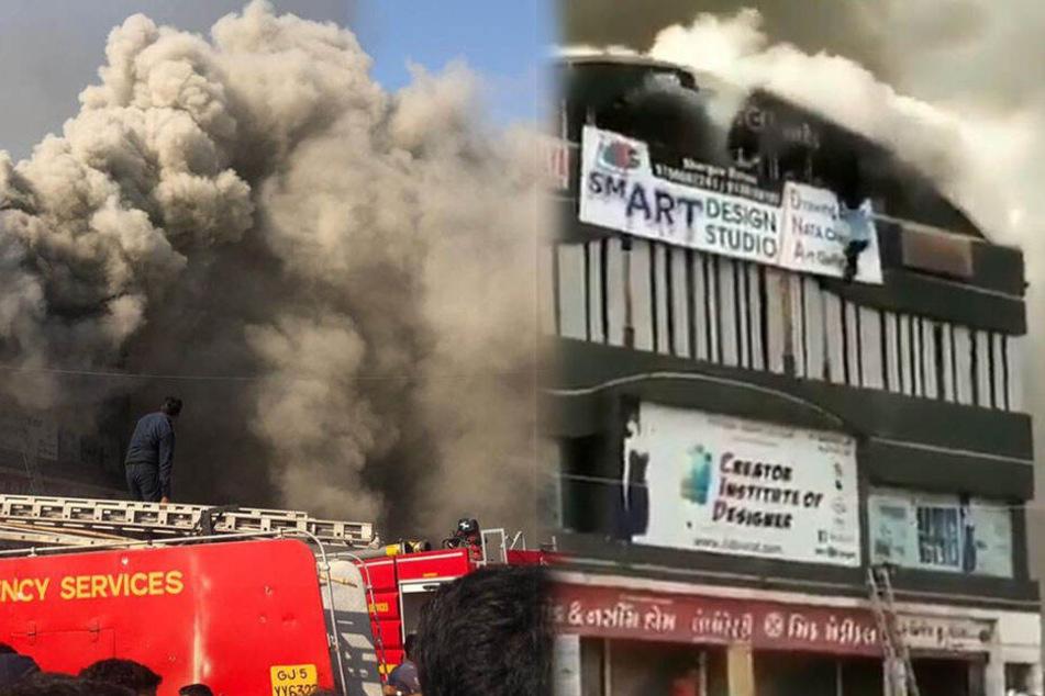 Menschen retten sich aus dem brennenden Gebäude