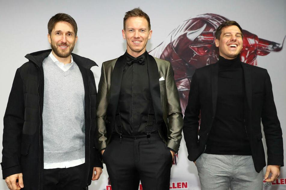 Brachten gute Laune mit: Benjamin Glück (Videoanalyst), Trainer Julian Nagelsmann und Teammanager Timmo Hardung (v.l.n.r.).