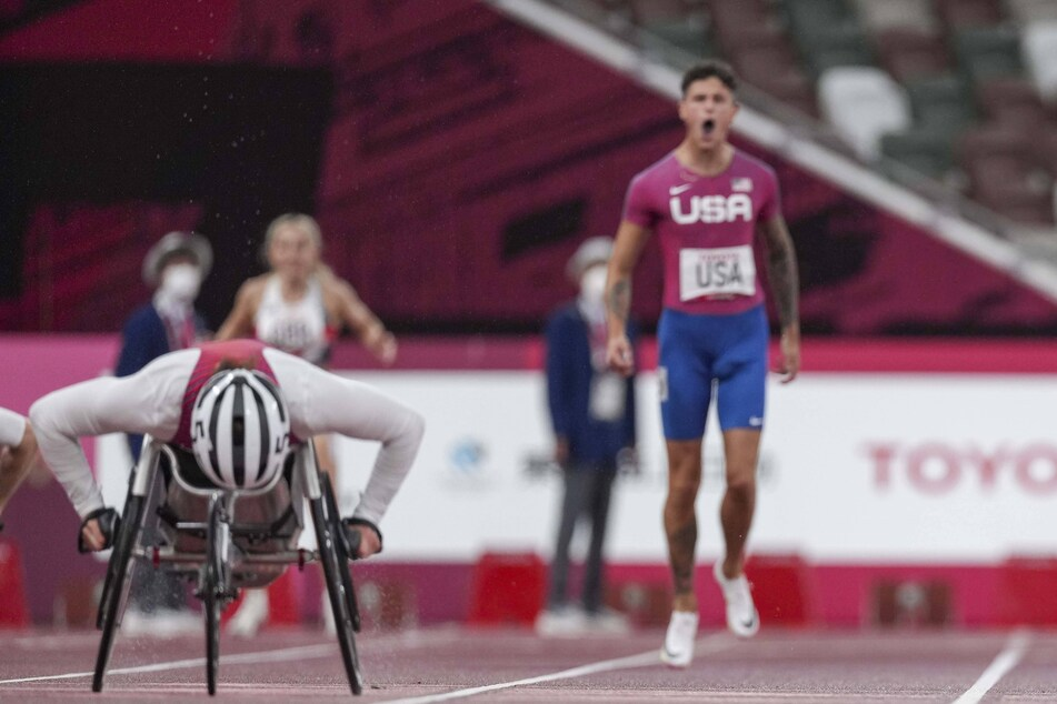 Nick Mayhugh (r.) cheered for relay teammate Tatyana McFadden (l.) in the 4x100-meter universal relay on Friday.