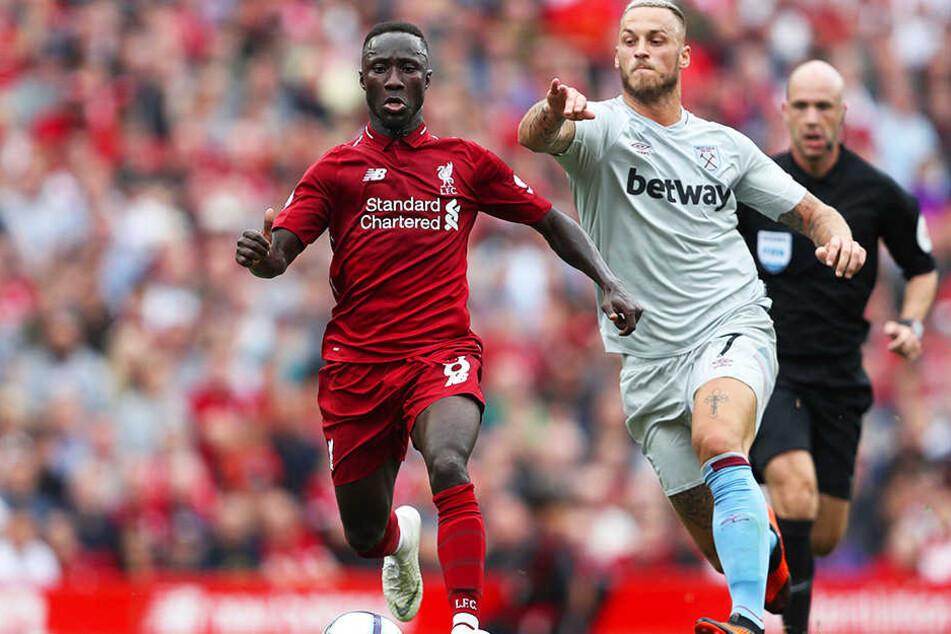 Zwei ehemalige Bundesliga-Stars im Duell: Liverpools Naby Keita (l.) und der frühere Bremer Marko Arnautovic.