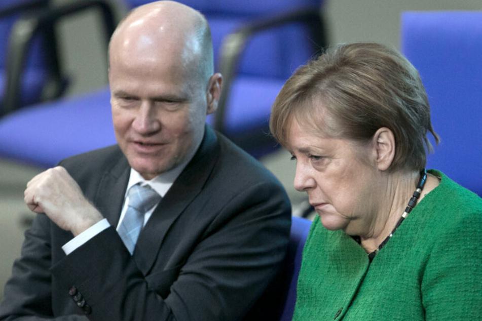 Der neue Mann an Angela Merkels (rechts) Seite im Bundestag: Ralph Brinkhaus (links).