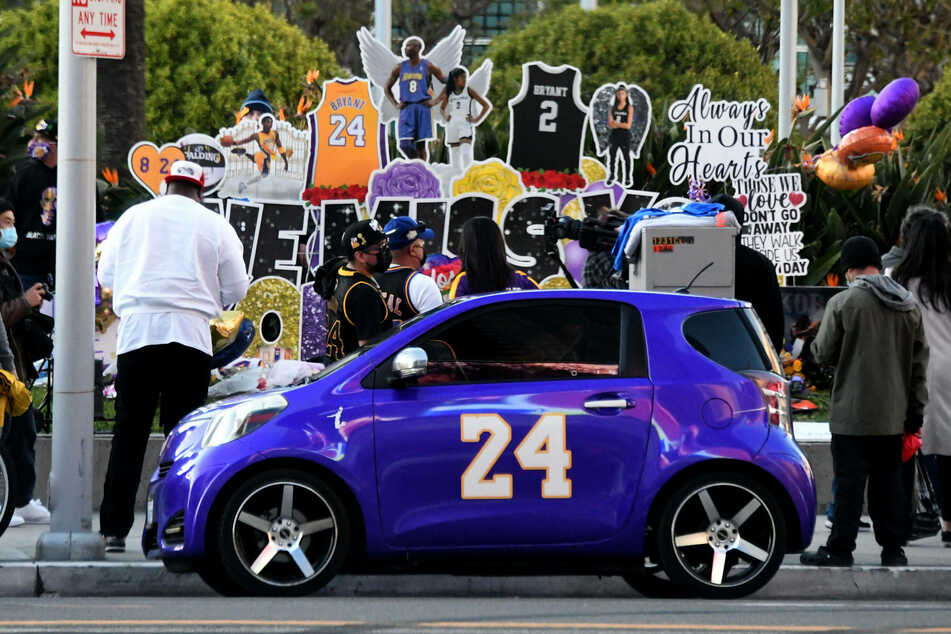 Fans honor the late basketball star and his daughter at a makeshift memorial outside the Staples Center in LA.