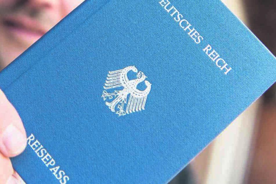 Reichsbürger erkennen die BRD nicht an, geben eigene Pässe von  Fantasieländern heraus.