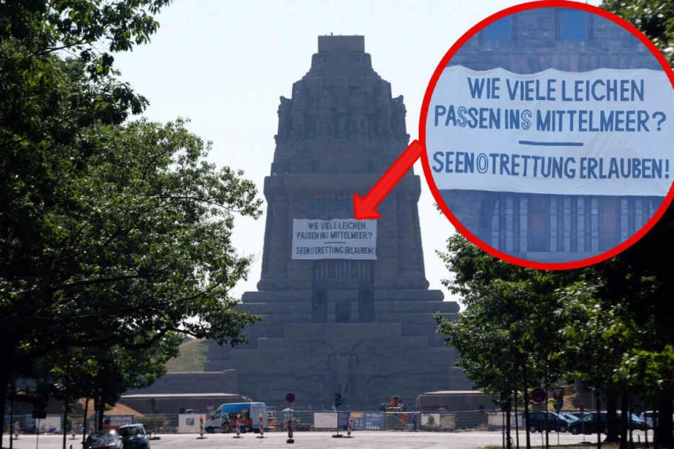 Riesiges Transparent am Völkerschlachtdenkmal heruntergelassen