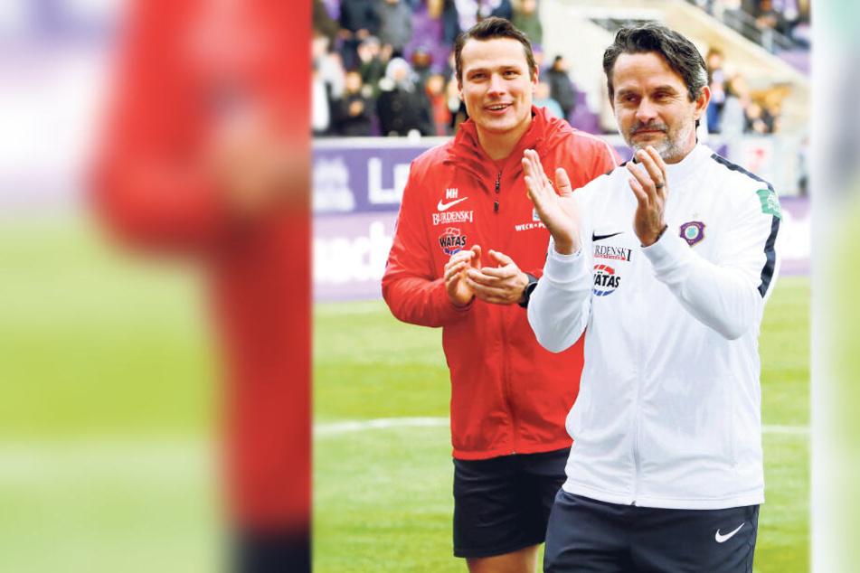 Hoffentlich können Chefcoach Dirk Schuster (r.) und Assistenztrainer Marc Hensel ihrer Mannschaft auch am Samstag nach dem Spiel beim VfB Stuttgart Beifall spenden ...