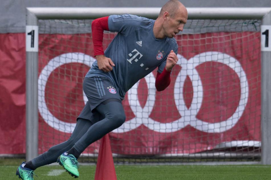 Arjen Robben und der FC Bayern München wollen gegen den VfL Wolfsburg einen Sieg.