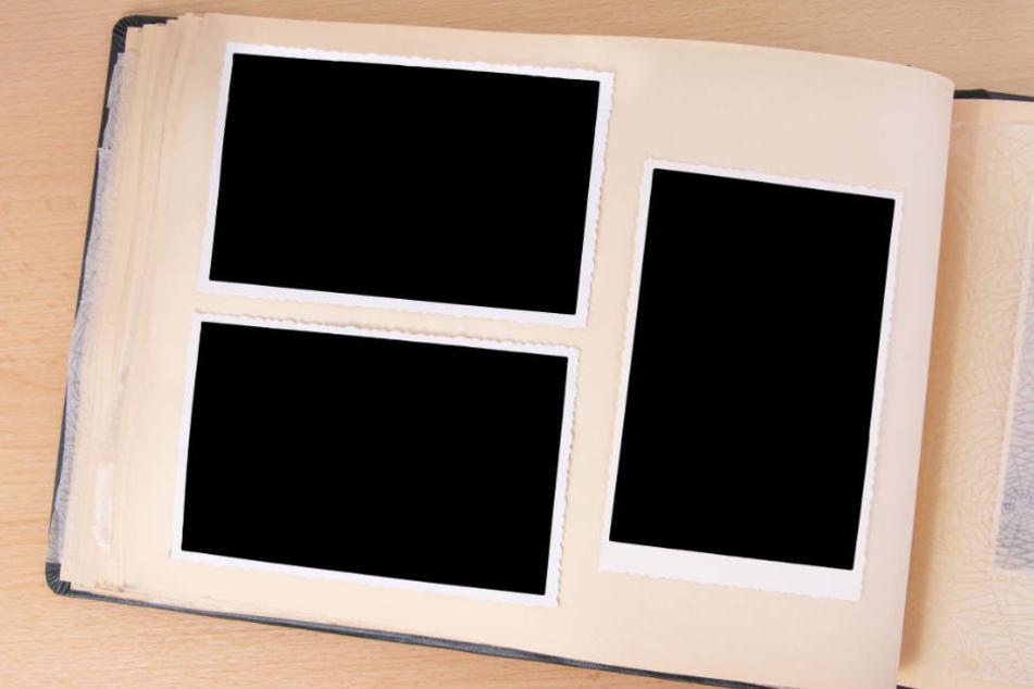 Ein Jahrbuch mit geschwärzten Fotos macht irgendwie wirklich keinen Sinn (Symbolbild).