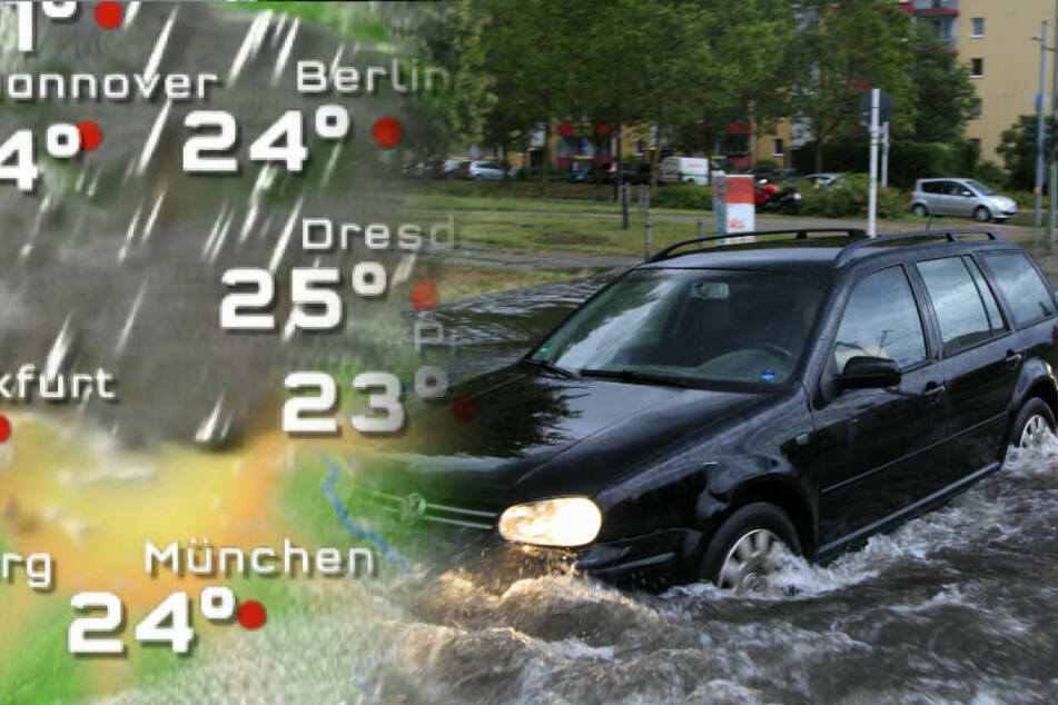 Ein Auto fährt über eine teilweise überflutete Straße.