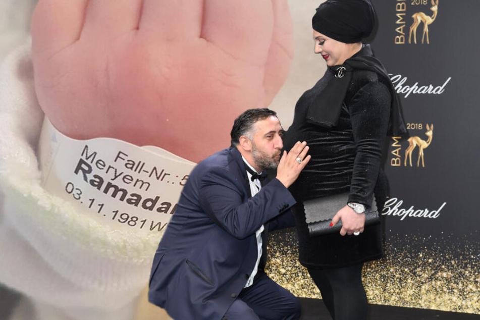 """Schauspieler Kida Khodr Ramadan küsst auf dem Roten Teppich für die Premiere der zweiten Staffel der TNT-Serie """"4 Blocks"""" den Bauch seiner schwangeren Frau Meryem (Bildmontage)."""