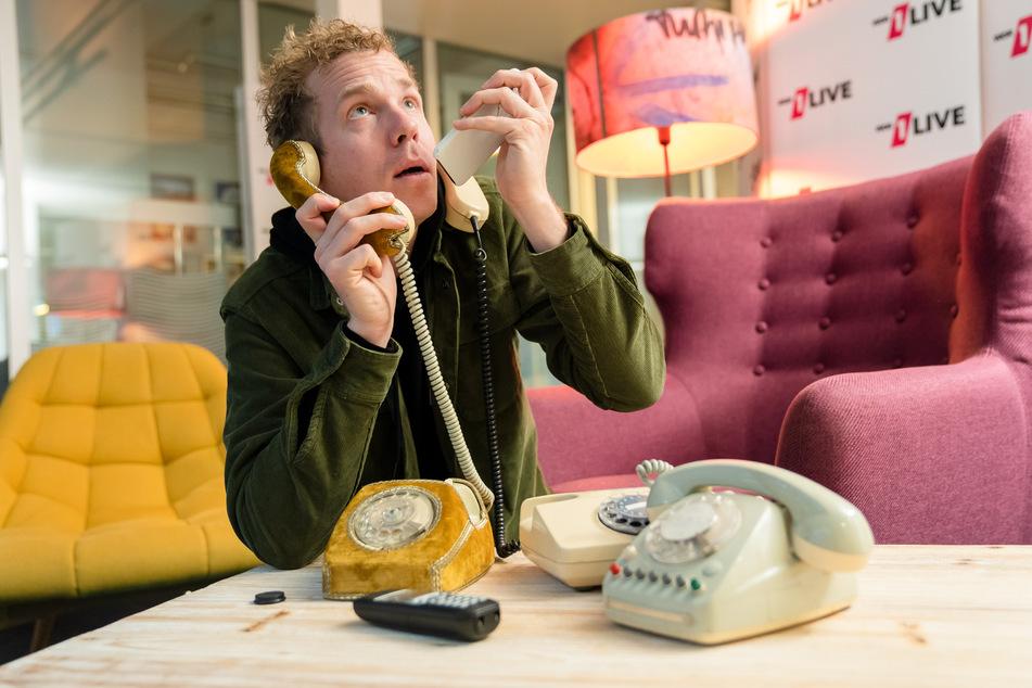 1Live-Reporter Daniel Danger (36) will für einen Rekord-Versuch im Dauer-Telefonieren mit Hunderten Menschen hintereinander sprechen.