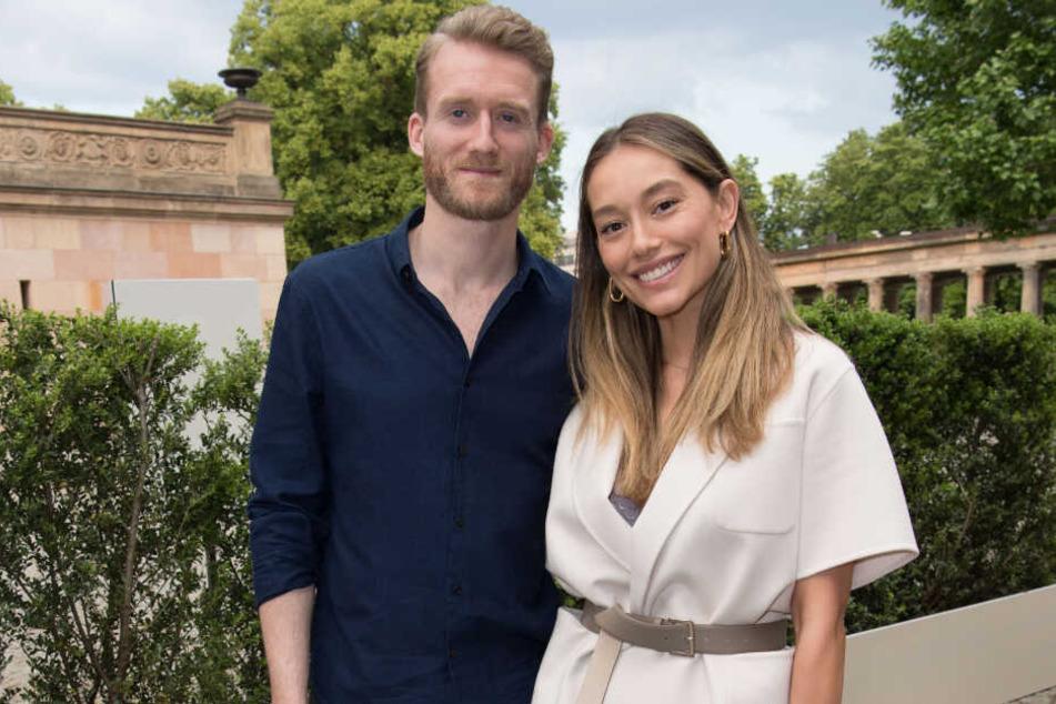 André Schürrle und seine Frau Anna kommen im Sommer 2019.