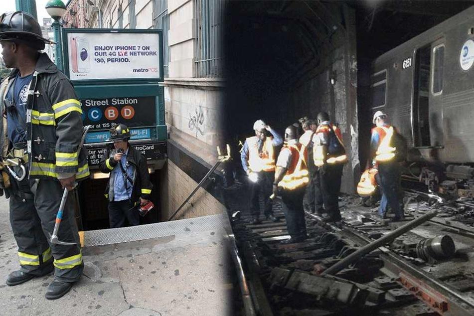 Feuerwehrmänner stehen am 27.06.2017 in New York (USA) vor einer U-Bahn Station bzw. im Tunnel. Eine U-Bahn ist in der Nähe des Stadtteils Harlem entgleist.