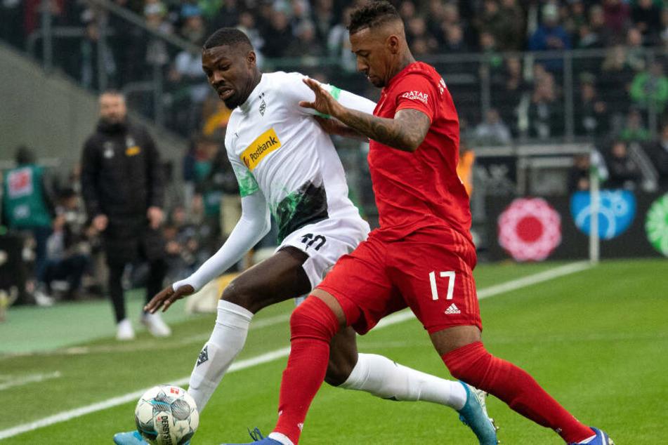 Jérôme Boateng (r.) musste gegen Mönchengladbach vorzeitig vom Feld.