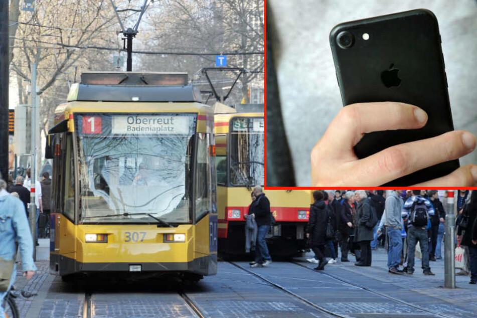 Die Jugendliche schaute aufs Handy - und wurde von einer Straßenbahn erfasst. (Symbolbild/Fotomontage)