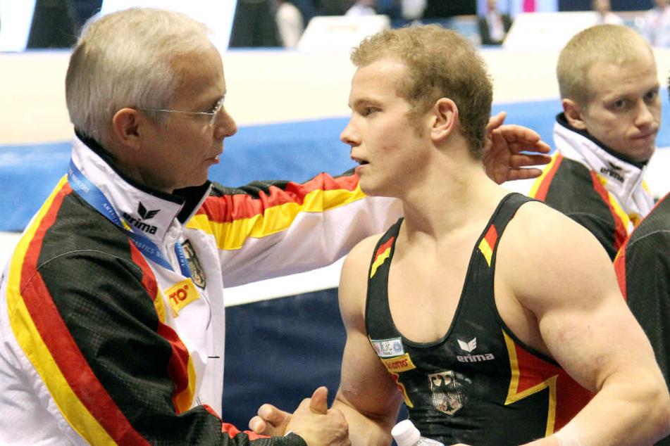 Trainer Andreas Hirsch und Fabian Hambüchen bei der Turn-WM 2011.
