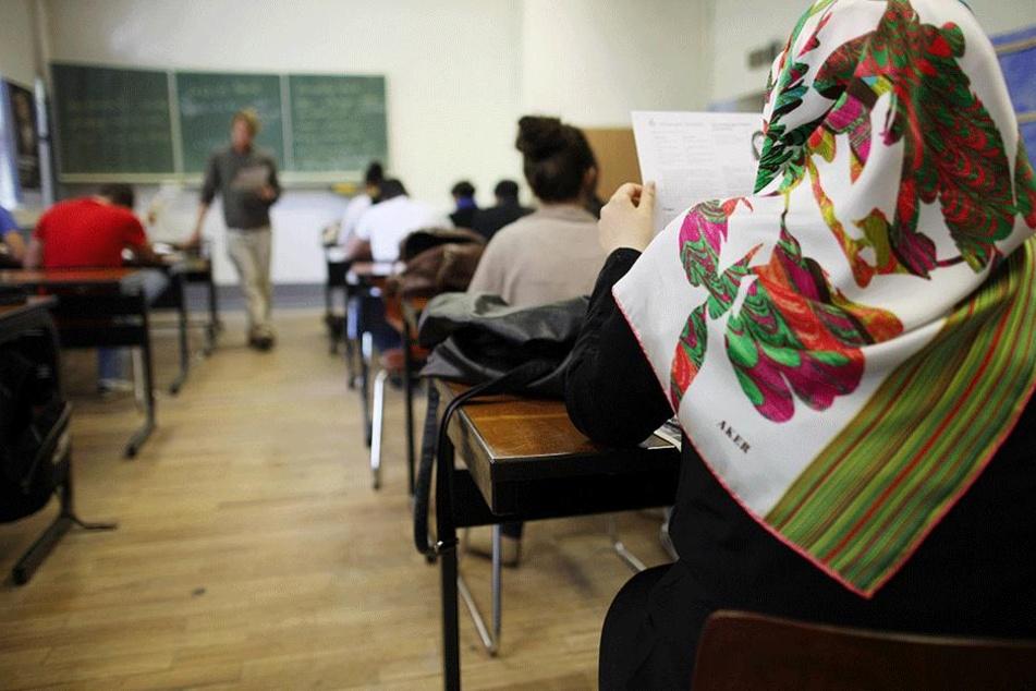 In Berliner Schulen ist es Alltag, dass Kinder vieler Kulturen und Nationalitäten gemeinsam lernen.