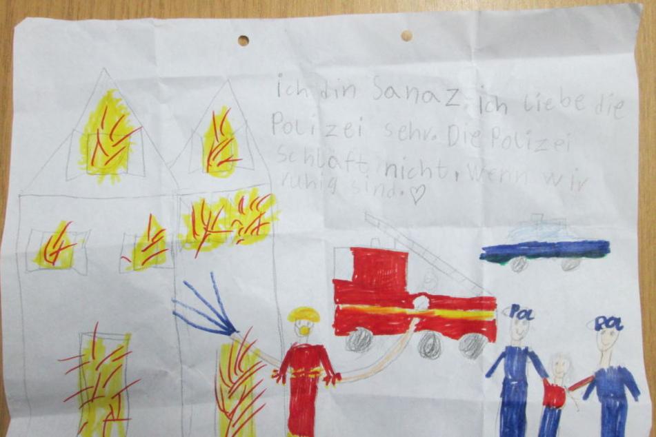 Dieses selbstgemalte Bild schenkte die Siebenjährige den Polizisten.