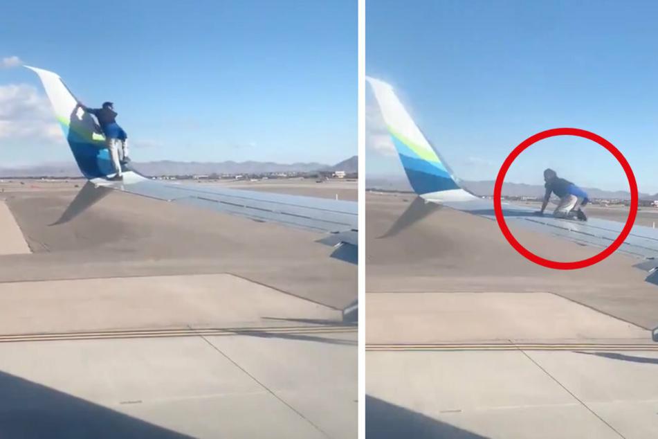 Flugzeug will abheben, da klettert ein Mann auf den Flügel!