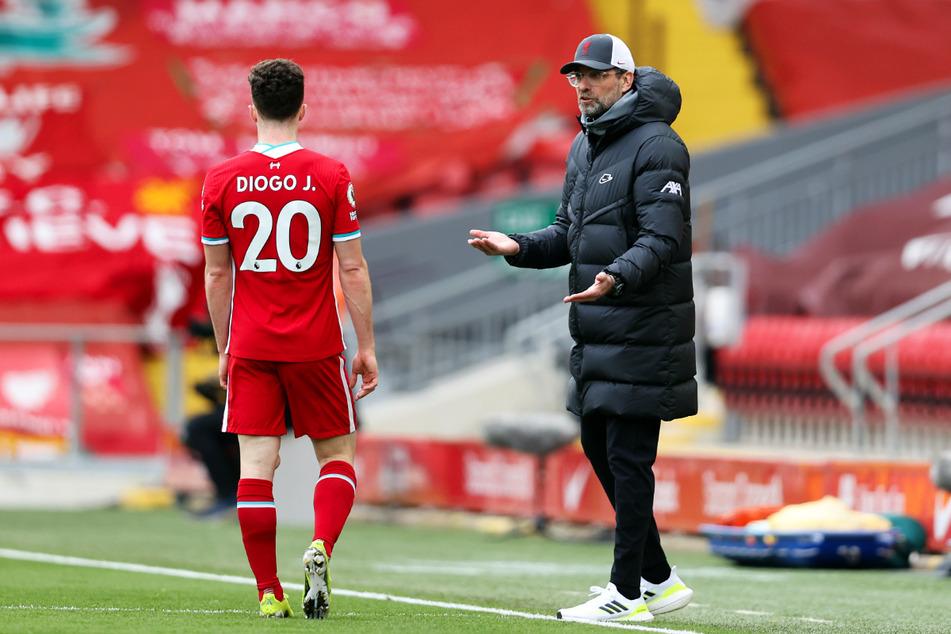 Findet Reds-Coach Jürgen Klopp (53, r.) noch einen Weg aus der Krise?