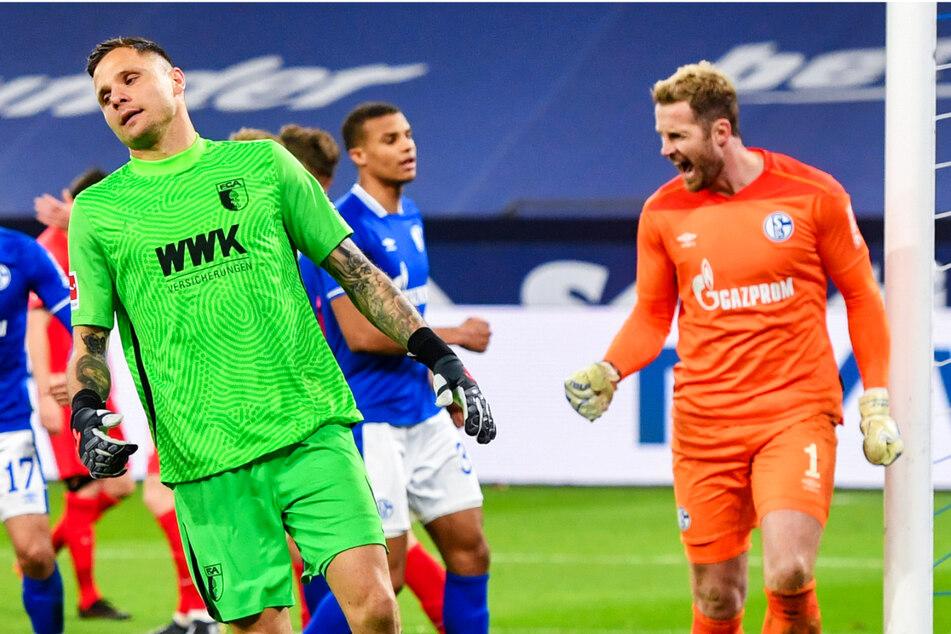 Gegensätzliche Emotionen: Während Knappen-Keeper Ralf Fährmann (32, r.) jubelt, dreht FCA-Torwart Rafal Gikiewicz (33) entnervt ab. Sein Fehler bescherte Schalke nämlich den Sieg.