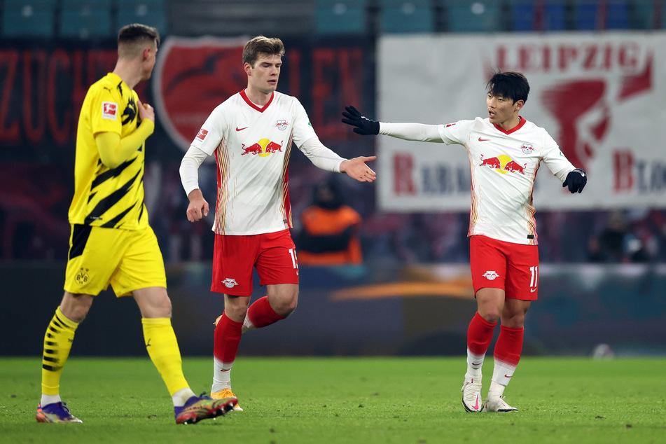 Sörloth (M.) erzielte in der 90. Minute das 1:3 für RB Leipzig - sein erstes Bundesligator.