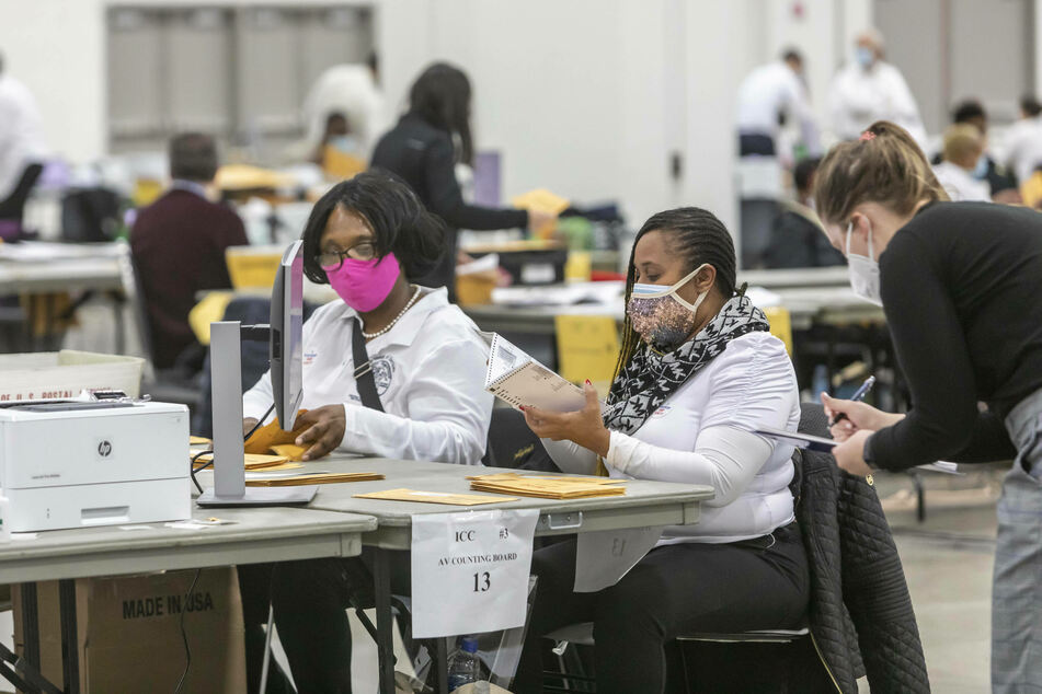 Workers for the Detroit Department of Elections count absentee ballots and early voting ballots in the 2020 presidential election.