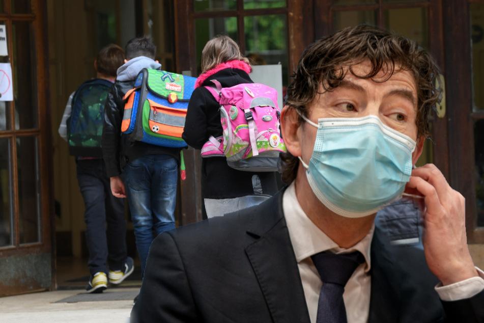 Virologe Christian Drosten (48, rechts) ist skeptisch, ob eine vorzeitige Öffnung von Schulen nicht das Infektionsgeschehen befeuert.