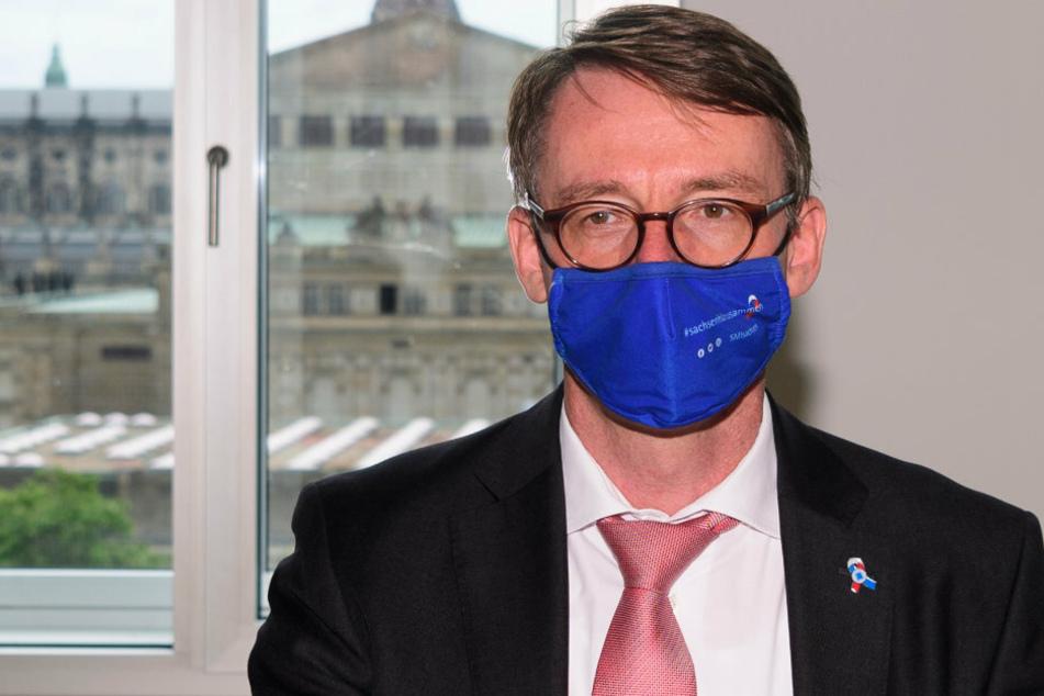 Roland Wöller (49, CDU), Innenminister von Sachsen, verurteilt Extremismus in jeglicher Form.