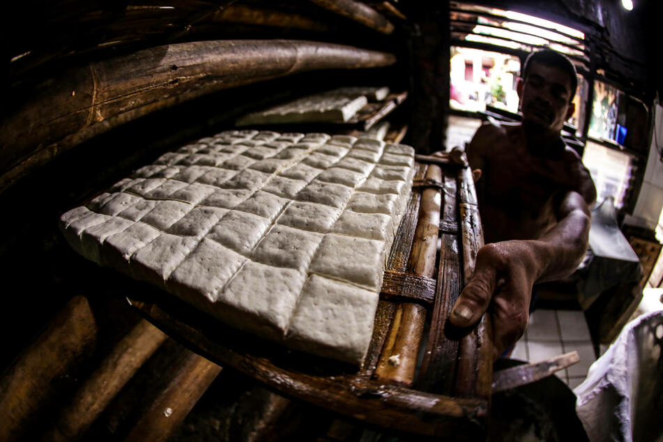 Workers prepare tofu in a small plant in West Java, Indonesia (stock image). Tofu has been a traditional component of many Asian cuisines for over a thousand years.