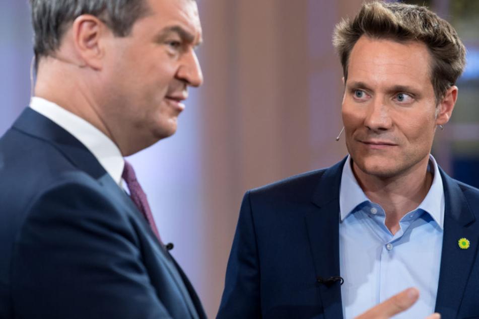 Markus Söder (l.) sieht eine mögliche Koalition mit den Grünen skeptisch. (Archivbild)