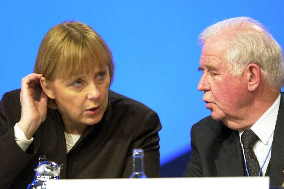 Die damals noch sehr junge Angela Merkel und Kurt Biedenkopf.