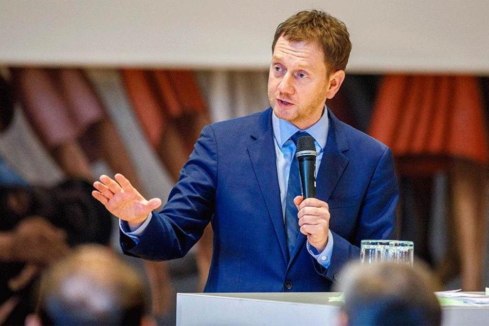 Auch Sachsens Landesvater Michael Kretschmer (42) warb für Verständnis um den Vertrag.