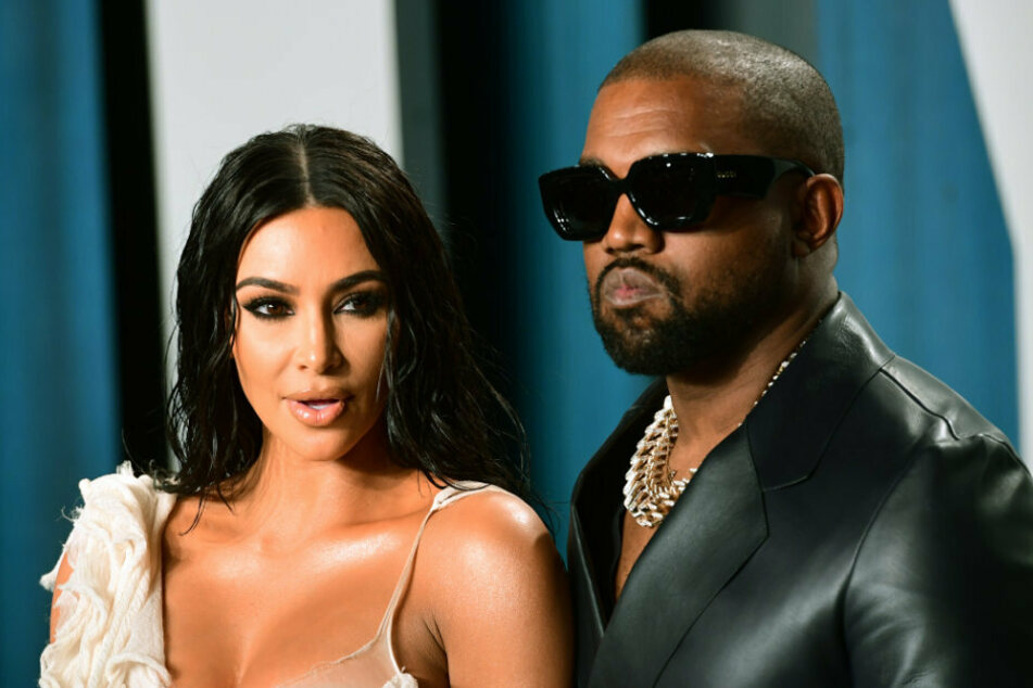 """Kanye West calls himself """"Baby Putin"""" and pees on his Grammy Award"""