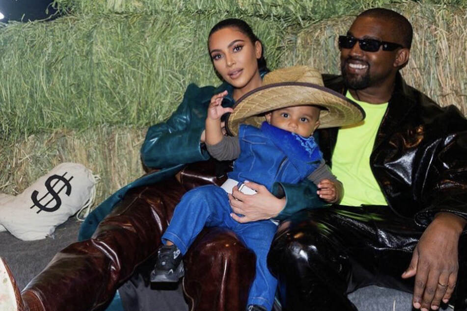 Kim Kardashian with Kanye West and their son Psalm (m) at Kanye's ranch in Wyoming for their daughter North's birthday party,