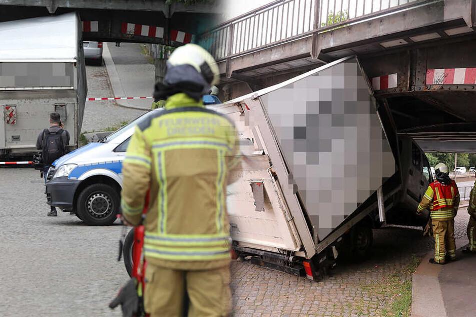Transporter bleibt unter Brücke stecken und die Helfer stehen vor einem Problem