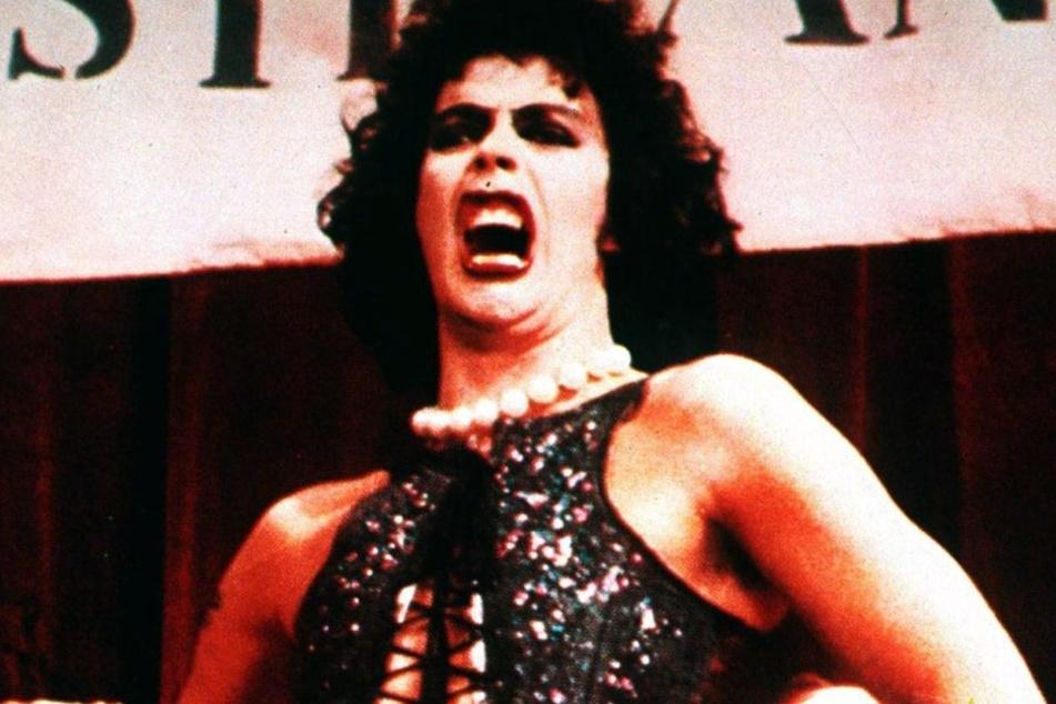 """Der Schauspieler und Sänger Tim Curry in dem Kultfilm """"Rocky Horror Picture Show""""."""