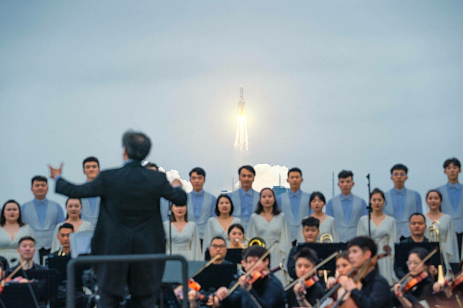 Members of Xi an Symphony Orchestra performed on the beach at the launch.