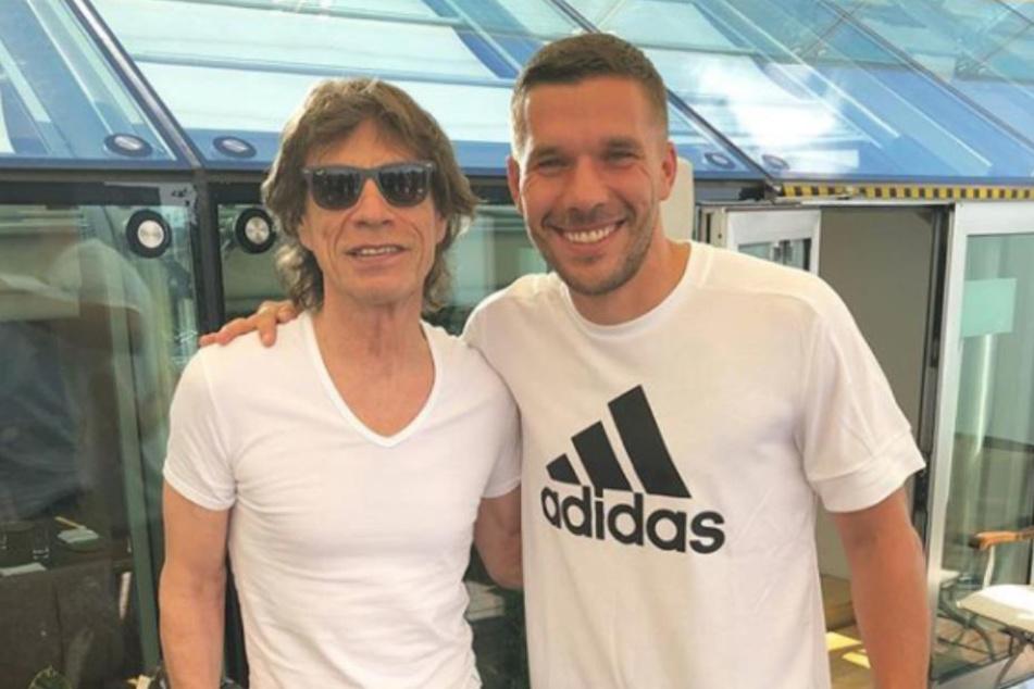 Ehrengast Mick Jagger und Weltmeister 2014 Lukas Podolski.
