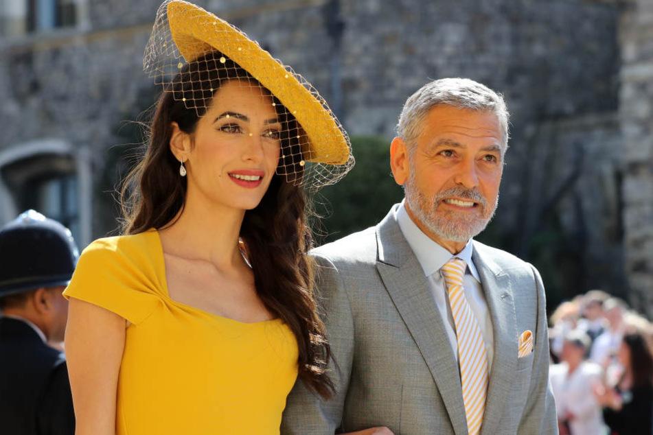 Ob Amal und George Clooney wirklich die Paten von Harrys und Meghans Kind werden?
