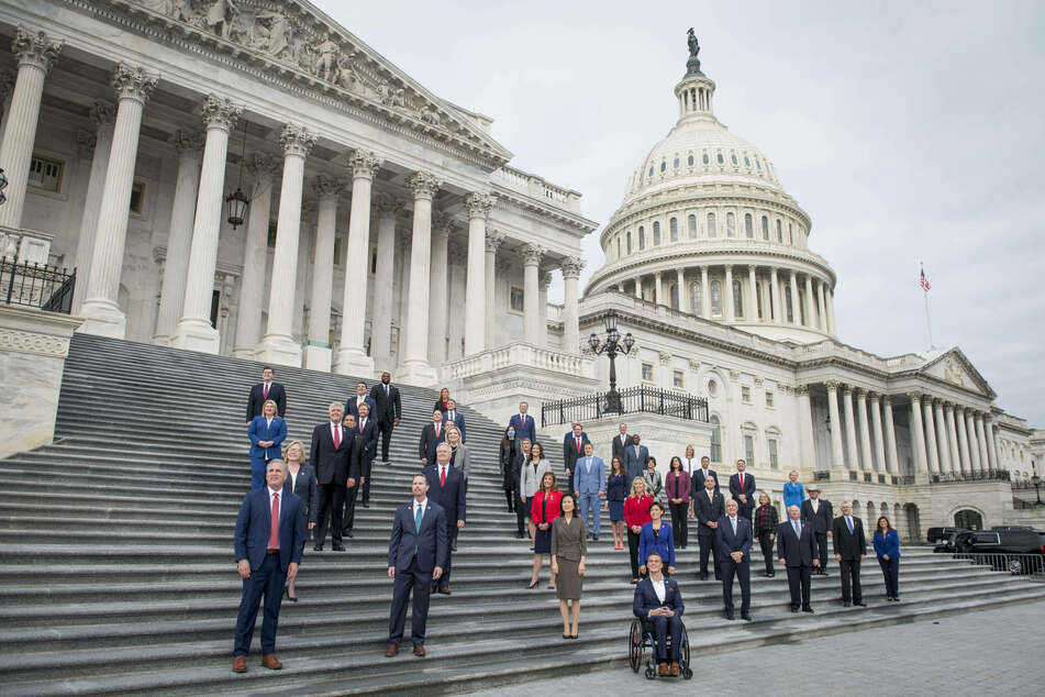 Newly sworn-in GOP members of Congress – including Mary Miller – pose for a group photograph on the East Front Steps of the US Capitol, just two days before it was stormed.