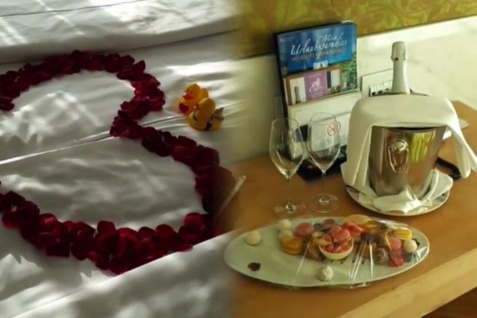 Romantik pur: Rosenherz auf dem Bett, Schampus und Leckereien daneben. (Fotomontage/Screenshots)