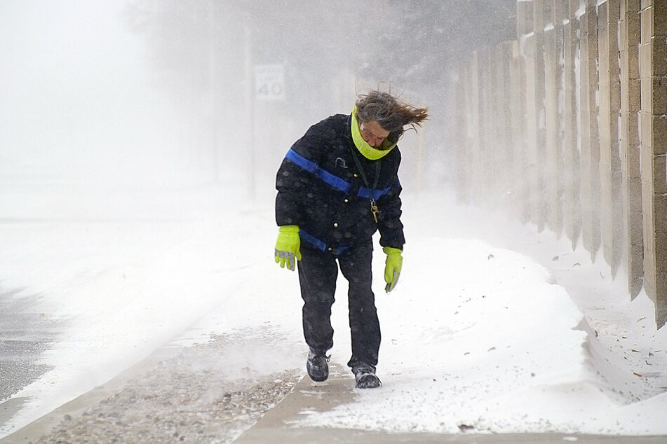 Albuquerque, New Mexico: a woman struggles to keep her balance amid frigid temperatures, snow and winds.