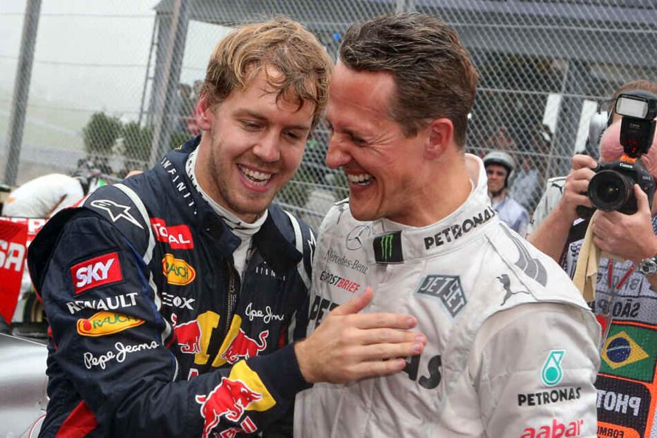 Sebastian Vettel im Jahr 2012 mit Michael Schumacher.
