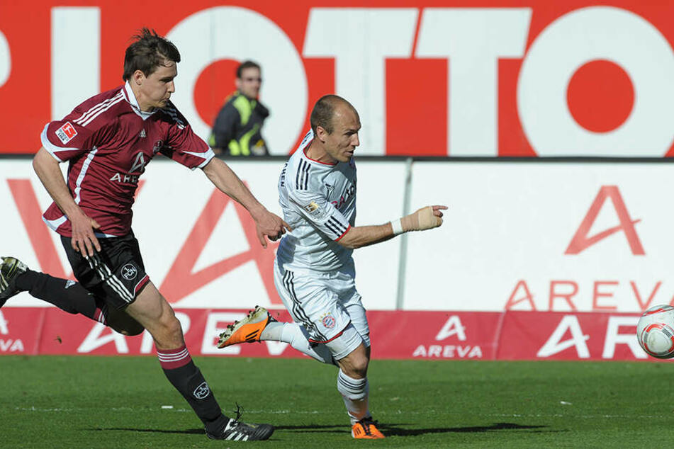 Seine ersten Bundesliga-Minuten sammelte der Innenverteidiger beim 1.FC Nürnberg. Hier im Duell gegen Bayern-Legende Arjen Robben.