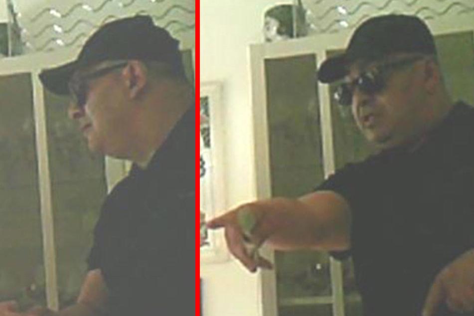 Dieser Mann wurde bei einer Geldaushändigung von einer Kamera aufgenommen.