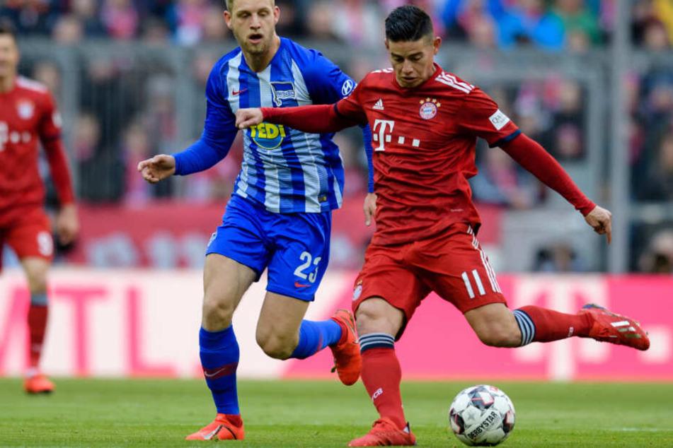 James Rodríguez (r.) und der FC Bayern München taten sich gegen Berlin schwer.