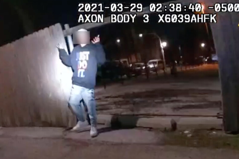 A still from the bodycam footage released by the Chicago PD, showing Adam Toledo turning around with his hands up just before he was fatally shot by Officer Eric Stillman.
