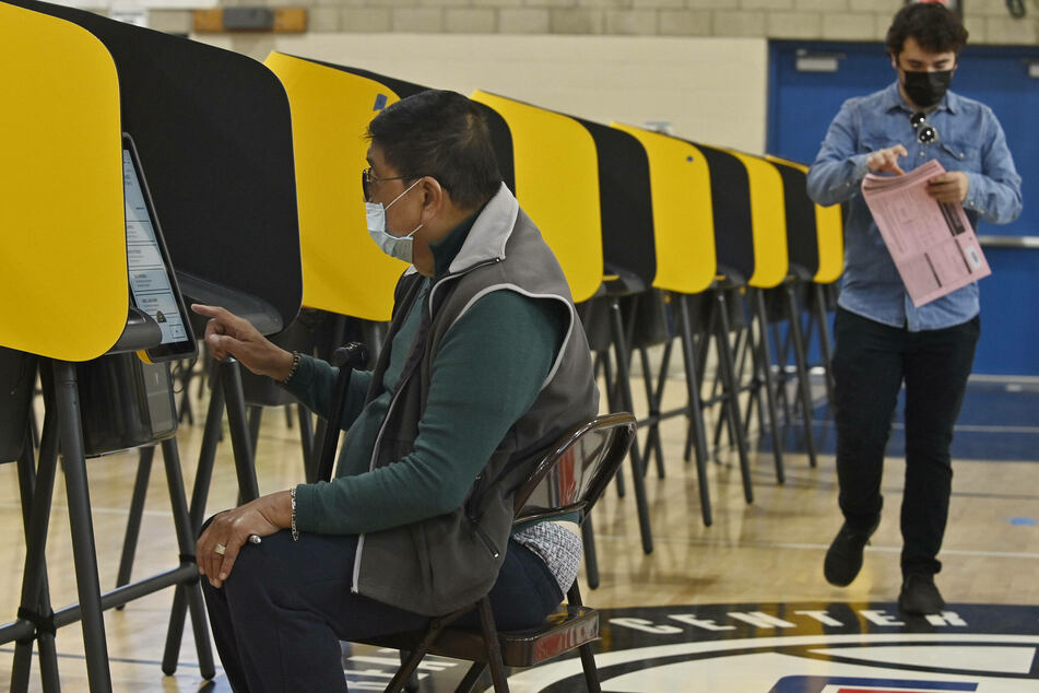 Voters cast their ballots in California's gubernatorial recall election on Tuesday. Voters are being asked two questions on their recall ballots: The first is whether Gov. Gavin Newsom should be recalled, and the second is who should succeed him in the event he is.