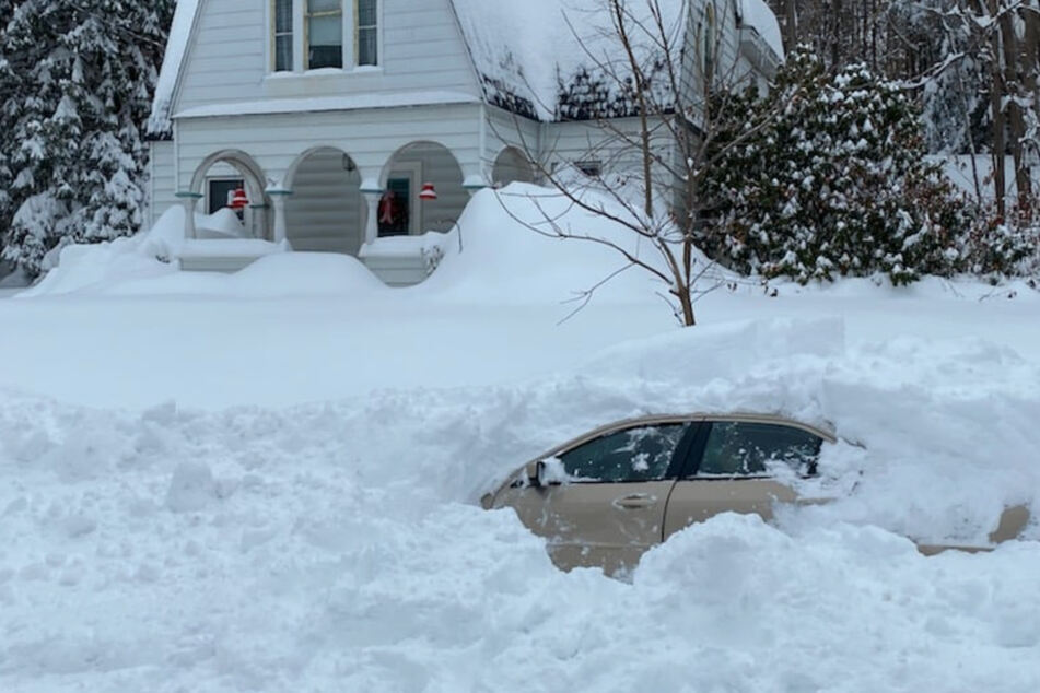 Upstate New York driver rescued from car buried under four feet of snow