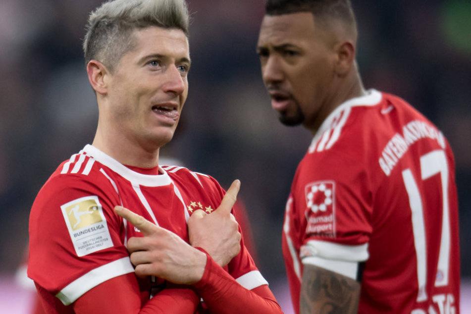 Robert Lewandowski (l.) und Jérôme Boateng sorgen beim FC Bayern München nicht gerade für Ruhe.